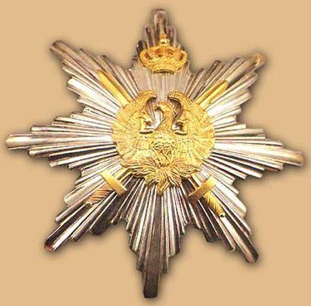 Звезда ордена Феникса с мечами.