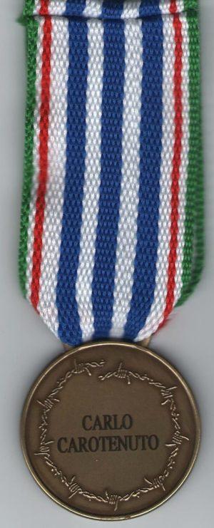 Аверс и реверс медали депортированным и интернированным.