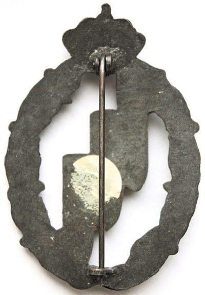 Аверс и реверс знака бомбардировщик в серебре. Королевство.
