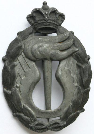 Аверс и реверс знака офицера стратегической разведки в серебре. Королевство.