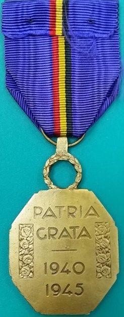 Аверс и реверс золотой медали Бельгийской Признательности.