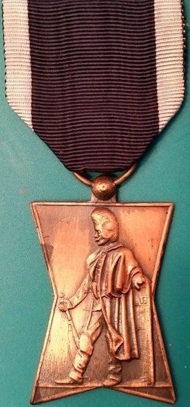 Аверс и реверс памятной медали бельгийских жандармов.