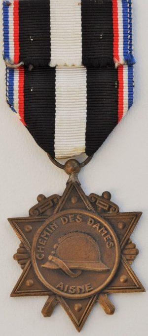 Аверс и реверс медали выживших Эна.