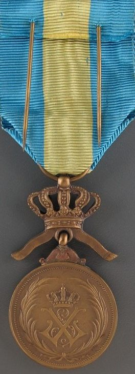 Аверс и реверс бронзовой медали ордена Африканской звезды.