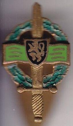 Петличный знак Королевской Федерации военных за границей.