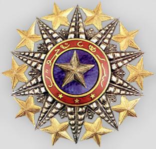 Золотая звезда к знаку Кавалера Большого креста ордена Нишан-эль-Ануара.