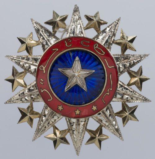 Серебряная звезда к знаку Великого офицера ордена Нишан-эль-Ануара.