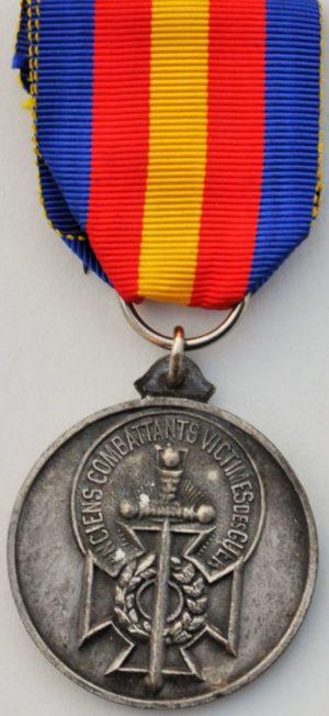 Аверс и реверс медали Ассоциации ветеранов жертв войны.