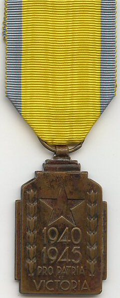 Знак медали «За службу в колониях во время войны 1940-1945».