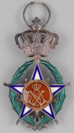 Аверс и реверс знака Кавалера Африканской Звезды.