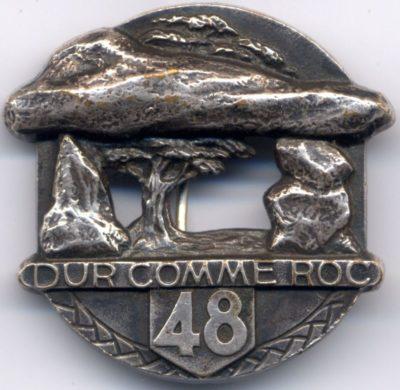 Аверс и реверс знака 48-го пехотного полка.