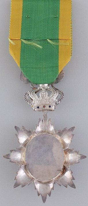 Аверс и реверс серебряного знака Кавалера ордена Дракона Аннамы.