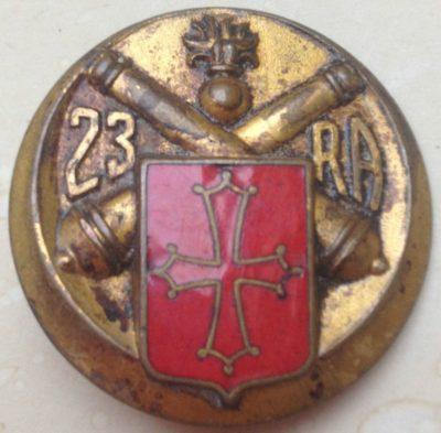 Аверс и реверс знака 23-го артиллерийского полка.