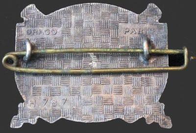 Аверс и реверс знака 33-го артиллерийского полка.