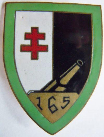 Аверс и реверс знака позиций 165-го артиллерийского полка.