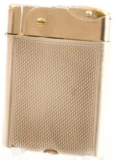 Зажигалка австрийской фирмы Flatty, выпускалась с 1933 года.