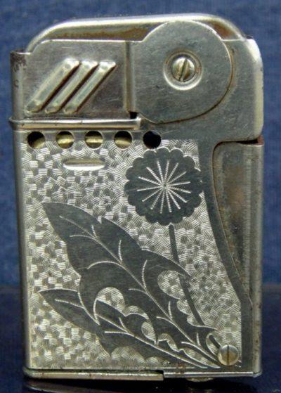 Зажигалка «Roxy» австрийской фирмы TCW, выпускалась с 1940 года.