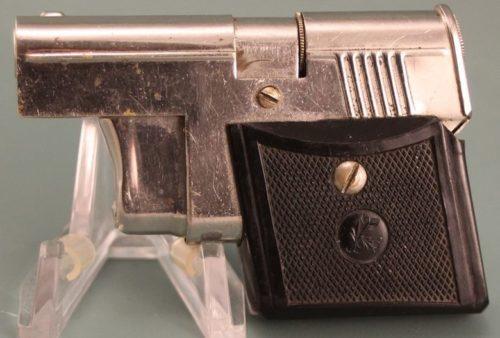 Зажигалка-пистолет немецкой фирмы Müller & Grünstein, выпускалась с 1932 года.