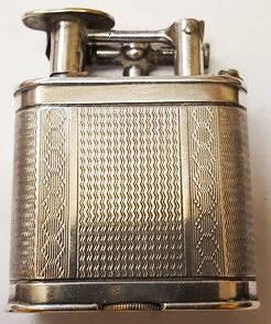 Зажигалка «Unique А» фирмы Dunhill, выпускалась в 1930-х годах.