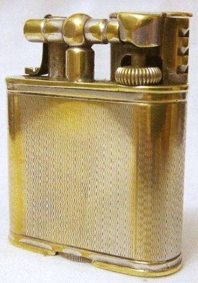 Зажигалки «Unique Sport» фирмы Dunhill, выпускались в 1930-х годах.