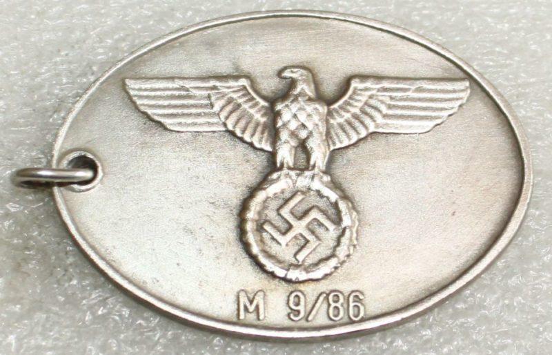 Жетон сотрудника Гестапо.