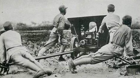 Китайские солдаты с противотанковым орудием. Шанхай, 1937 г.