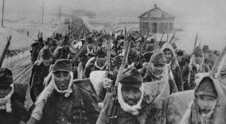 Солдаты японской 16-й дивизии на марше в Китае. Январь 1938 г.
