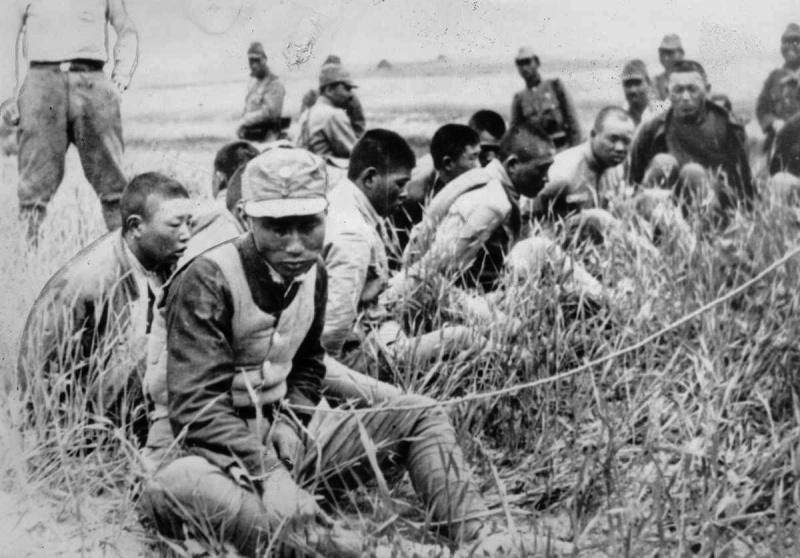 Китайские военнопленные в ожидании казни. 1938 г.