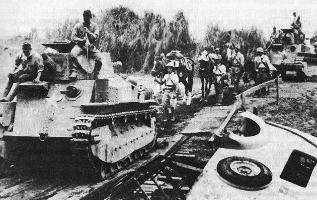 Японские танки наступают на Манилу.