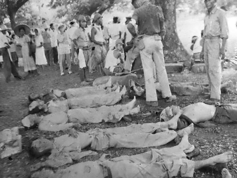 Погибшие американские и филиппинские солдаты на марше.