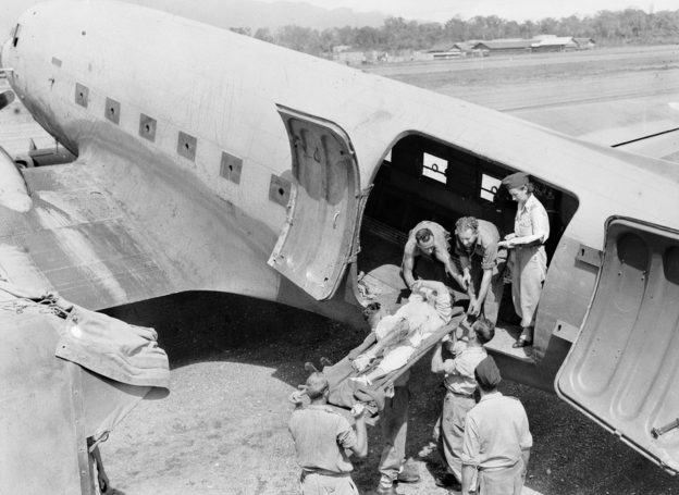 Погрузка раненных в санитарный самолет. 1944 г.