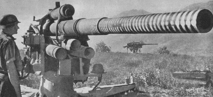 Батарея 88-мм немецких орудий, использовавшихся для борьбы с танками и десантными судами Союзников.
