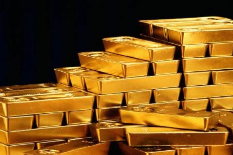 Золотые слитки для банковского хранения весом 400-тройских унций или 12,4 кг.