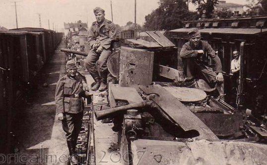 Разбитый эшелон советских танков на железнодорожной станции. Июль 1941 г.