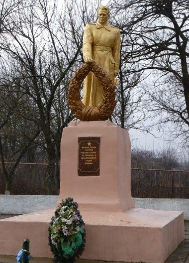 с. Любимовка Софиевского р-на. Памятник, установленный на братской могиле советских воинов, погибших в боях за село и памятный знак погибшим односельчанам.