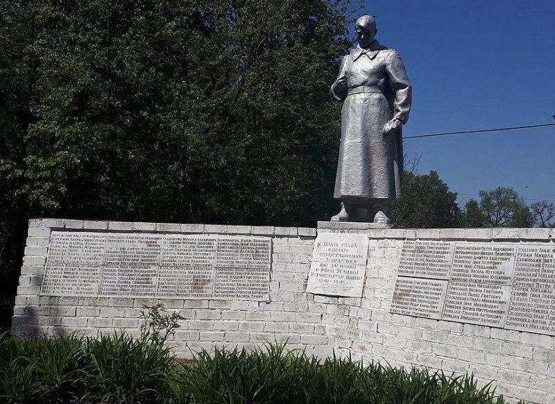с. Довгаловка Талалаевского р-на. Братская могила 3 советских воинов, погибших при обороне села в августе 1941 года и памятный знак 122 воинам-односельчанам, погибшим в годы войны.