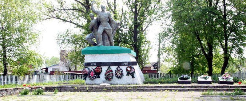 с. Забара Андрушевского р-на. Группа братских могил, в которых похоронено 9 советских воинов и памятный знак воинам-односельчанам.